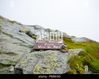 'Fragile vegetation'. Can be killed by footsteps. Please stay on trails.' sign in the Camels Hump mountain in Vermont - Stock Photo