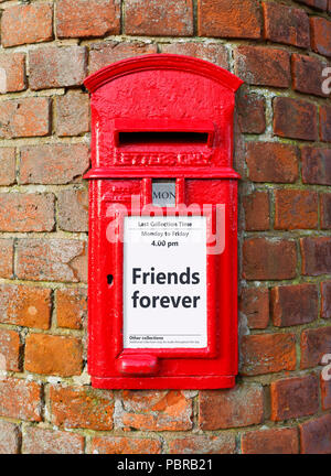 British post box with a message that reads Friends Forever, ideal for a greeting card design - Stock Photo