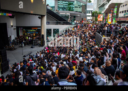 Bangkok, Thailand - May 1, 2018: Crowd of people in front of a shopping center waiting for the concert of an unidentified asian band in a shopping cen - Stock Photo