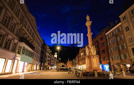 Beautiful twilight view of Our Lady statue in Innsbruck old town shopping street, Innsbruck, Tyrol, Austria, Europe - Stock Photo