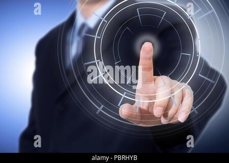Businessman pressing modern technology cyber panel - Stock Photo