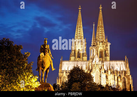 Equestrian statue of Emperor Wilhelm II. with Cologne Cathedral in the blue hour, Cologne, Rhineland, North Rhine-Westphalia - Stock Photo