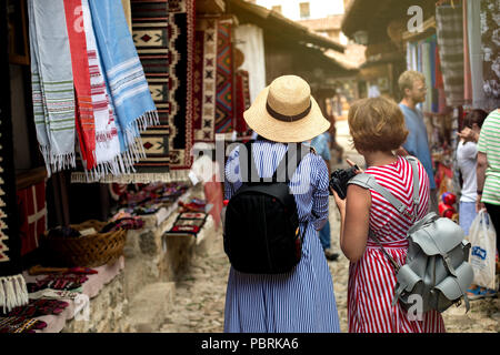 Kruje, Albania - June 2018: Tourists at traditional Ottoman market in Kruja. - Stock Photo