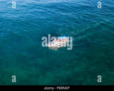aerial ship in the sea going on the dirty polluted harmful water - Stock Photo