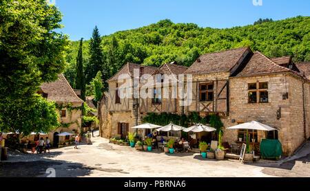 Square of Saint-Cirq-Lapopie on  Santiago de Compostela pilgrimage road, labelled as a Les Plus Beaux Villages de France - Stock Photo