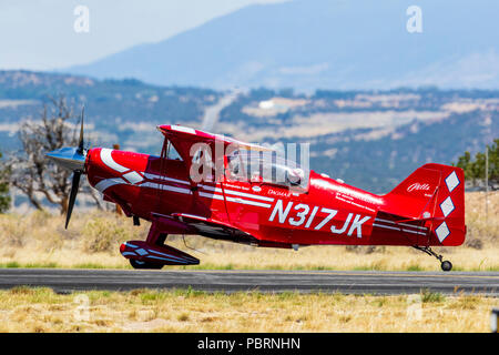 Female pilot, Pitts Special S2C biplane; Metro State University of Denver Aerobatics Team; Salida Fly-in & Air Show; Salida; Colorado; USA - Stock Photo