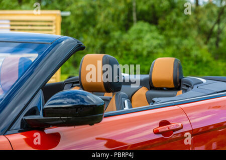 Modern Luxury car inside. Interior of prestige modern cabriolet car. Comfortable leather seats. Modern car interior details.