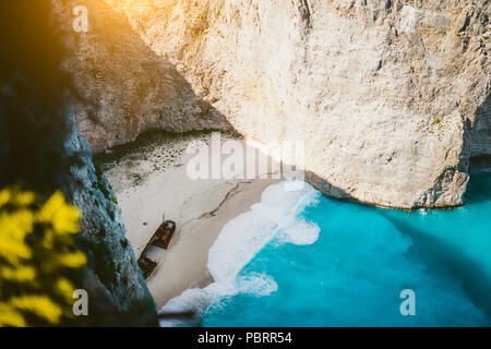 Navagio beach Zakynthos with shipwreck in the warm morning light. Greece - Stock Photo