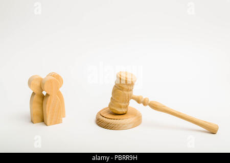 Three men and a hammer of the judge. The trial of cases in court, the resolution of a dispute between two people. Business relations, ascertaining the - Stock Photo