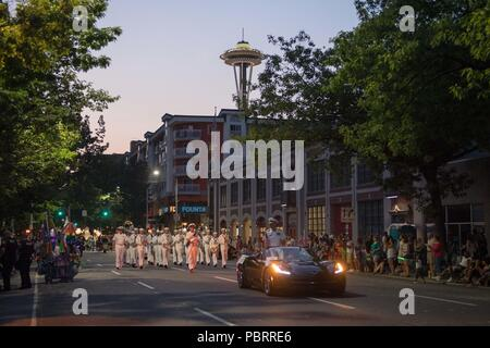 180728-N-DA737-0335 SEATTLE (July 28, 2018) Rear Adm. Scott Gray, commander, Navy Region Northwest, and the Navy Band Northwest marching band, participate in the Alaska Airlines Seafair Torchlight Parade in Seattle as part of the 69th annual Seafair Fleet Week. Seafair Fleet Week is an annual celebration of the sea services wherein Sailors, Marines and Coast Guard members from visiting U.S. Navy and Coast Guard ships and ships from Canada make the city a port of call. (U.S. Navy photo by Mass Communication Specialist 2nd Class Jonathan Jiang/Released) - Stock Photo