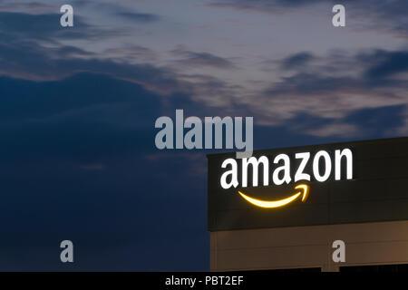 Illuminated signage at the Amazon fulfillment centre located in Warrington, UK. - Stock Photo