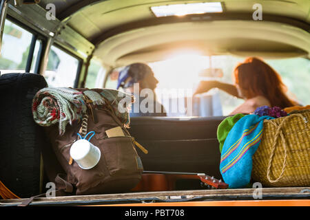 Senior hipster couple going on vacation in a camper van - Stock Photo