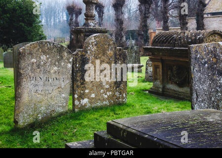Tombs and headstones in a typical English church graveyard - Stock Photo