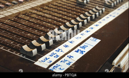 Audio mixing desk for sound channels for a live band concert at a festival - Stock Photo