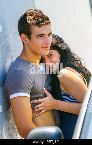 Young couple closeness emotive emotion emotions fulfilled satisfied satisfaction - Stock Photo