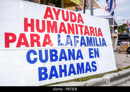 Miami Florida Little Havana Calle Ocho banner activist human rights organization humanitarian aid Cubans Bahamas Spanish languag - Stock Photo