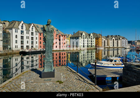 statue in front of view of old harbor with historical Art Nouveau buildings, Ålesund, Norway, Europe - Stock Photo