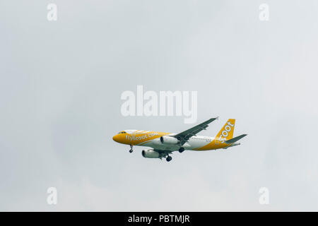 Singapore - June 03 2018: Airliner on final Approach into Changi Airport. - Stock Photo
