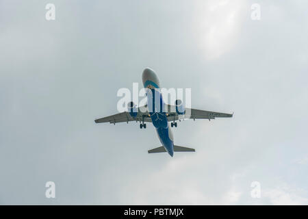 Singapore - June 03 2018: Indian Airliner on final Approach into Changi Airport - Stock Photo