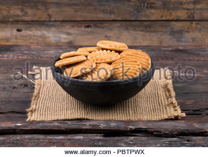Biscuit sweet cookie background. Domestic stacked butter biscuit pattern concept - Stock Photo