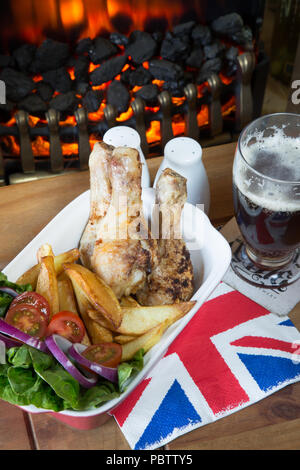 English pub meal of Roast Chicken drumsticks with chips/fries and a fresh mixed salad - Stock Photo
