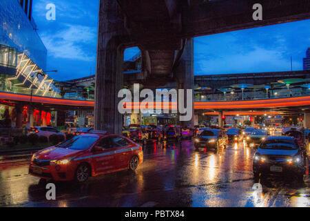 Bangkok, Thailand - May 1, 2018: Traffic jam at dusk during a storm on a busy road in Bangkok - Stock Photo