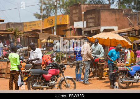 Small Town, Street Scene, Men with Motorcycles, Crowded Busy Market, Transport, East Africa, Uganda - Stock Photo