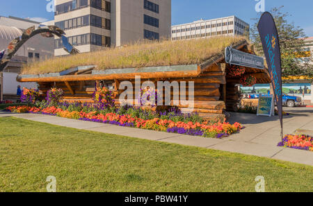 Anchorage, Alaska, USA - July 18, 2018: Anchorage Visitor Information Log Cabin in summertime. - Stock Photo