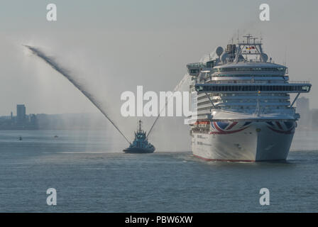 the P and O cruise liner or ocean liner AZURA leaving the port of Southampton docks with a tug spraing water testing firefighting equipment. - Stock Photo