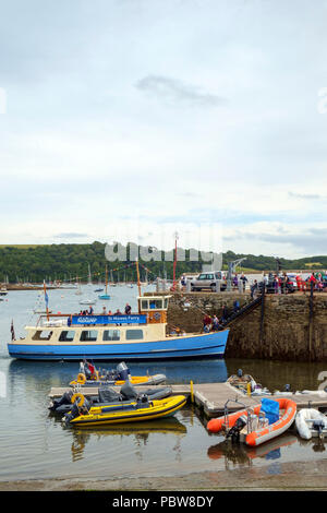 26th July 2017 - St Mawes, Cornwall: Passengers board The Duchess of Cornwall, a St Mawes Ferry boat, in the harbour on a summer afternoon at St Mawes on the Roseland Peninsula, Cornwall, UK - Stock Photo