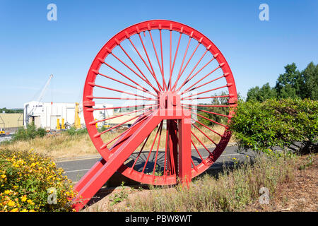 Pulley wheel from mining colliery on display outside The Stadium of Light, Vaux Brewery Way, Sunderland, Tyne and Wear, England, United Kingdom - Stock Photo