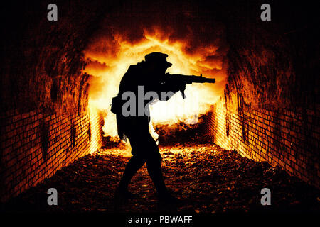 Stalker with gun exploring catacombs with fight - Stock Photo