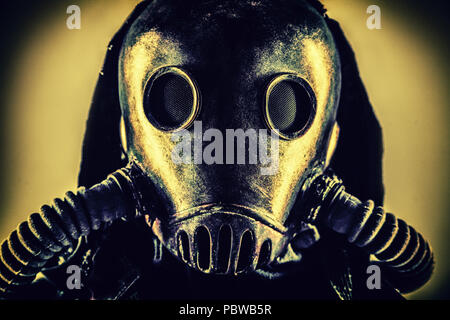 Portrait of post apocalyptic survivor in gas mask - Stock Photo