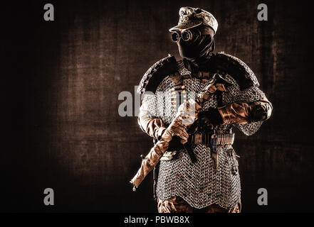 Post apocalyptic warrior with handmade firearm - Stock Photo
