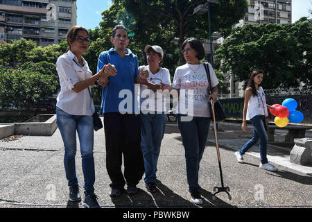 Caracas, Miranda, Venezuela. 30th July, 2018. A patient seen joining the protest.Nurses, doctors and patients protest in front of the World Health Organization offices in Caracas for the lack of medicines and treatment in the hospitals. The government led by President Nicolas Maduro still does not solve the problem in the health sector and does not allow the humanitarian aid of other nations. Credit: Roman Camacho/SOPA Images/ZUMA Wire/Alamy Live News - Stock Photo
