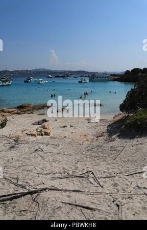 Sardinia, Italy. 30th July, 2018. Turquoise waters at Cala Soraya , Spragni island with many holiday maker yachts and boats moored off the coast. Spragni is one of the seven islands of the La maddalanea archipelago off the northern coast of Sardinia Credit: WansfordPhoto/Alamy Live News - Stock Photo