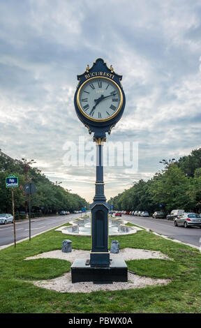 BUCHAREST, ROMANIA - 07.20.2018. Clock Bucharest 1459 on Union Boulevard in Romania in a summer morning - Stock Photo