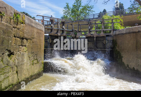Canal du Midi, Carcassonne, French department of Aude, Occitanie Region, France. Lock gates opening on the canal. - Stock Photo