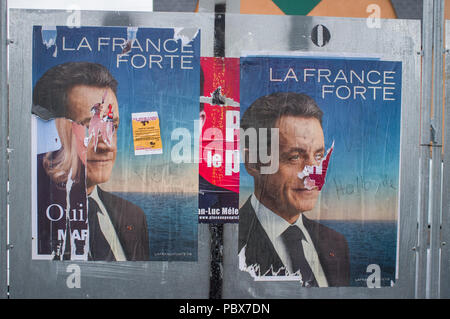 Torn French election poster for Nicolas Sarkozy, 'La France Forte'. - Stock Photo