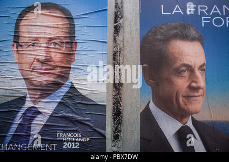 Torn French election poster for Nicolas Sarkozy and Francois Hollande, 'La France Forte', 'Changement', 2012 - Stock Photo
