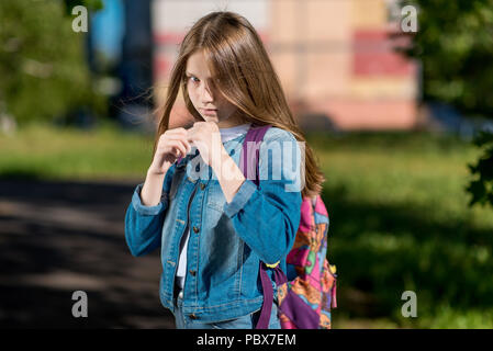 Girl schoolgirl. Summer in nature. It is in the rack. I'm ready to start a fight. The concept of child protection, attack conflicts, resistance problems. Emotion of Courage And self-confidence. - Stock Photo