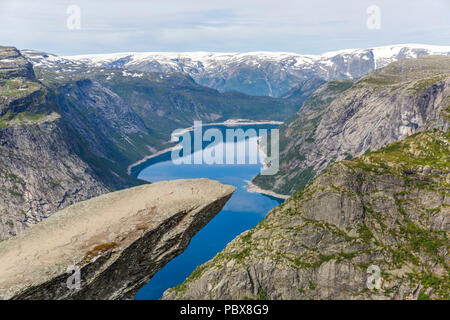 Trolltunga rock formation is one of the most popular and scenic places in Norway - Stock Photo
