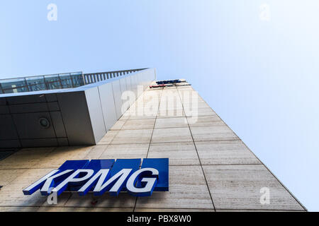 BELGRADE, SERBIA - JULY 21, 2018: KPMG logo on their main office for Serbia in Belgrade, in a business district. KPMG is one of the main audit firms i - Stock Photo