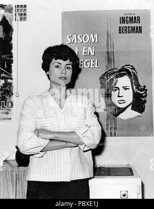 Ingmar Bergman. 1918-2007.  Swedish film director. Here the movie poster for Through a Glass Darkly and actress Harriet Andersson who plays a leading role in the film. 1962 - Stock Photo