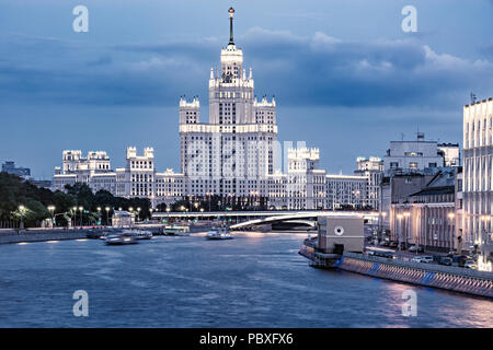 Retro skyscraper on Kotelnicheskaya embankment by Moscow river at sunset time. Moscow. Russia. - Stock Photo