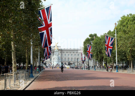 London / UK - July 26 2018: View of Buckingham Palace, the home of the British monarch, from along the Mall - Stock Photo