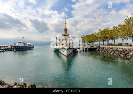 A paddle steamer, a unique and modern restored steamboat as commuter passenger ferry on Lake Geneva, Switzerland - Stock Photo
