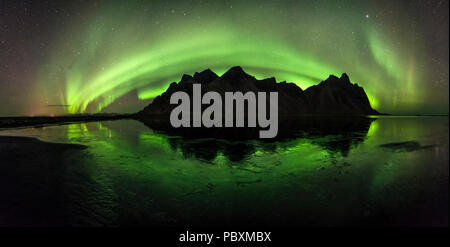 Aurora Borealis, Northern Lights over Vestrahorn mountain, Iceland, Europe - Stock Photo