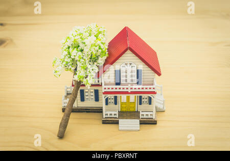 Fallen Tree Home Insurance Concept. Falling trees on home or house for insurance concept or disaster category. Home insurance concept in  business cat - Stock Photo