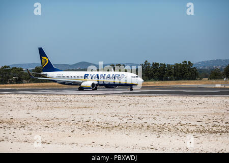 Faro, Portugal - July, 2018: Airliner from Ryanair takes off from Faro airport FAO during daytime. - Stock Photo